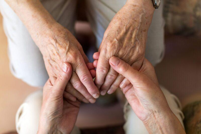 bigstock-nurse-consoling-her-elderly-pa-298175911-scaled-800x533